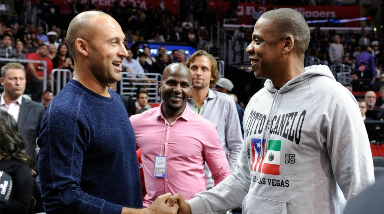 Jay Z, Derek Jeter shake hands briefly at Warriors Clippers game