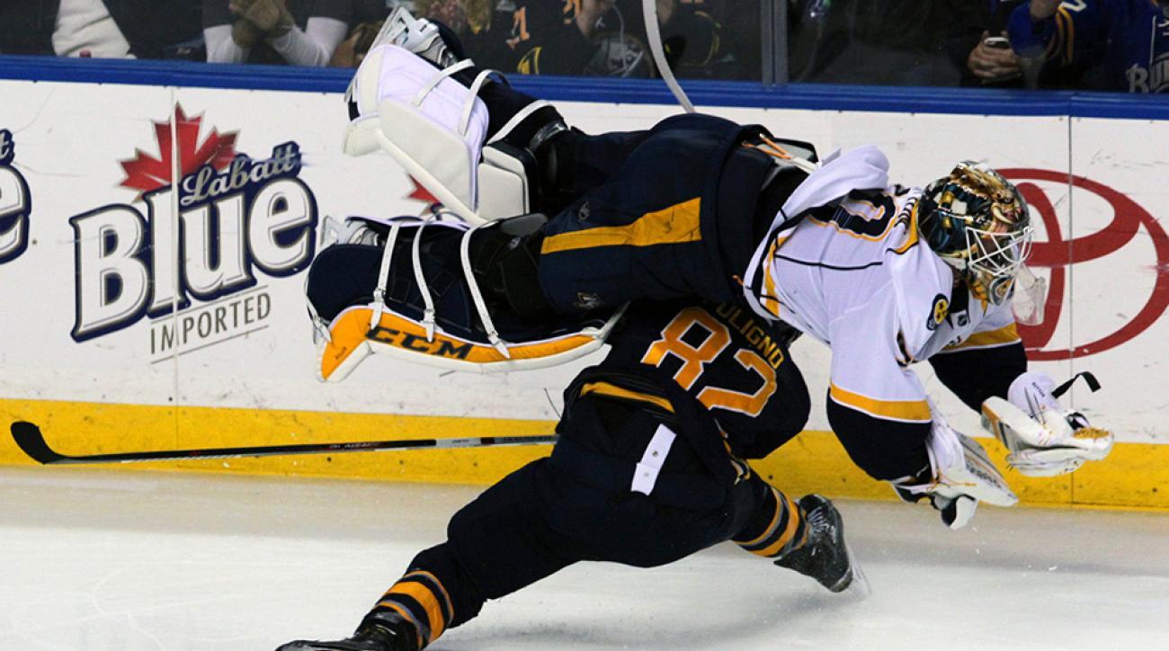 Predators goalie Carter Hutton flips over after a collision with Sabres' Foligno