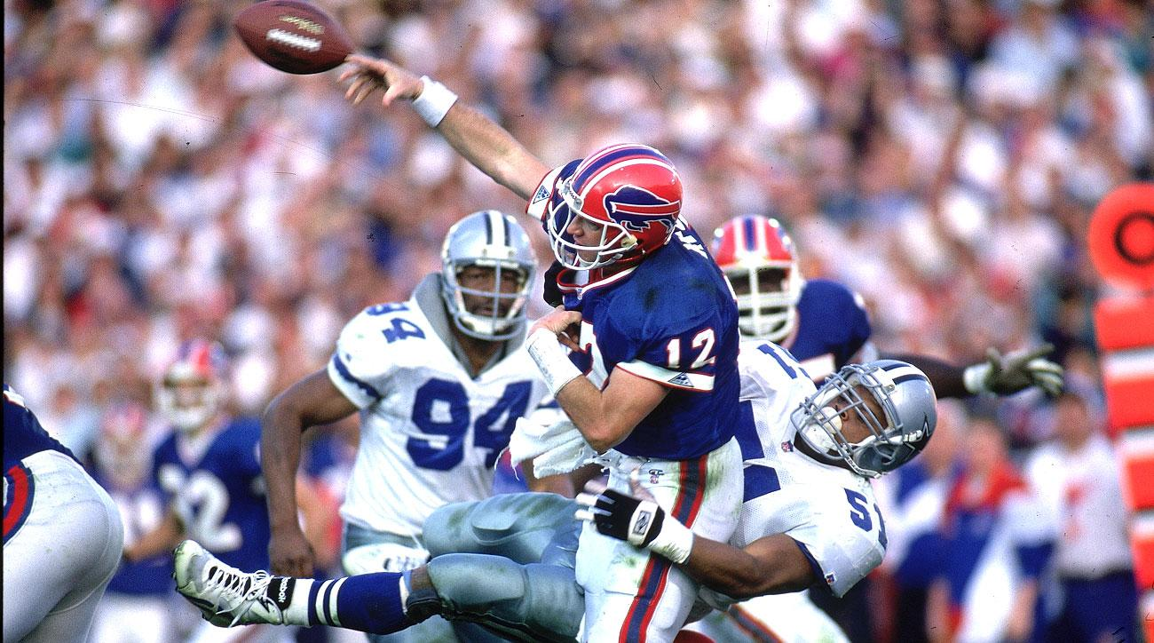 Jim Kelly of the Bills passing against the Cowboys in Super Bowl XXVII.