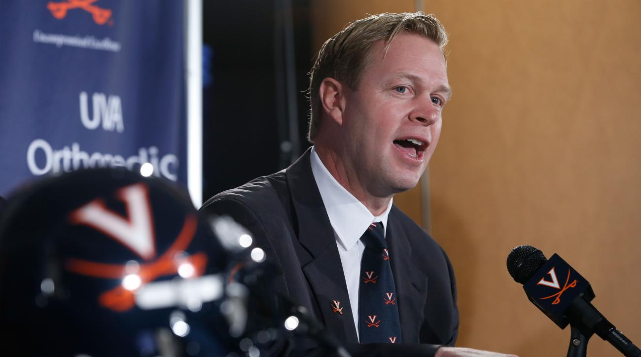 virginia cavaliers bronco mendenhall adds assistant coaches
