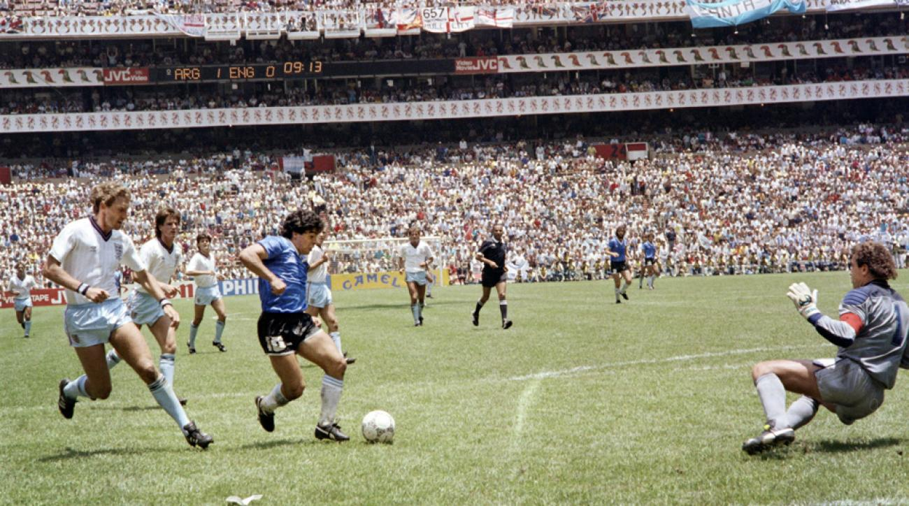 Diego Maradona scores the Goal of the Century for Argentina against England in the 1986 World Cup