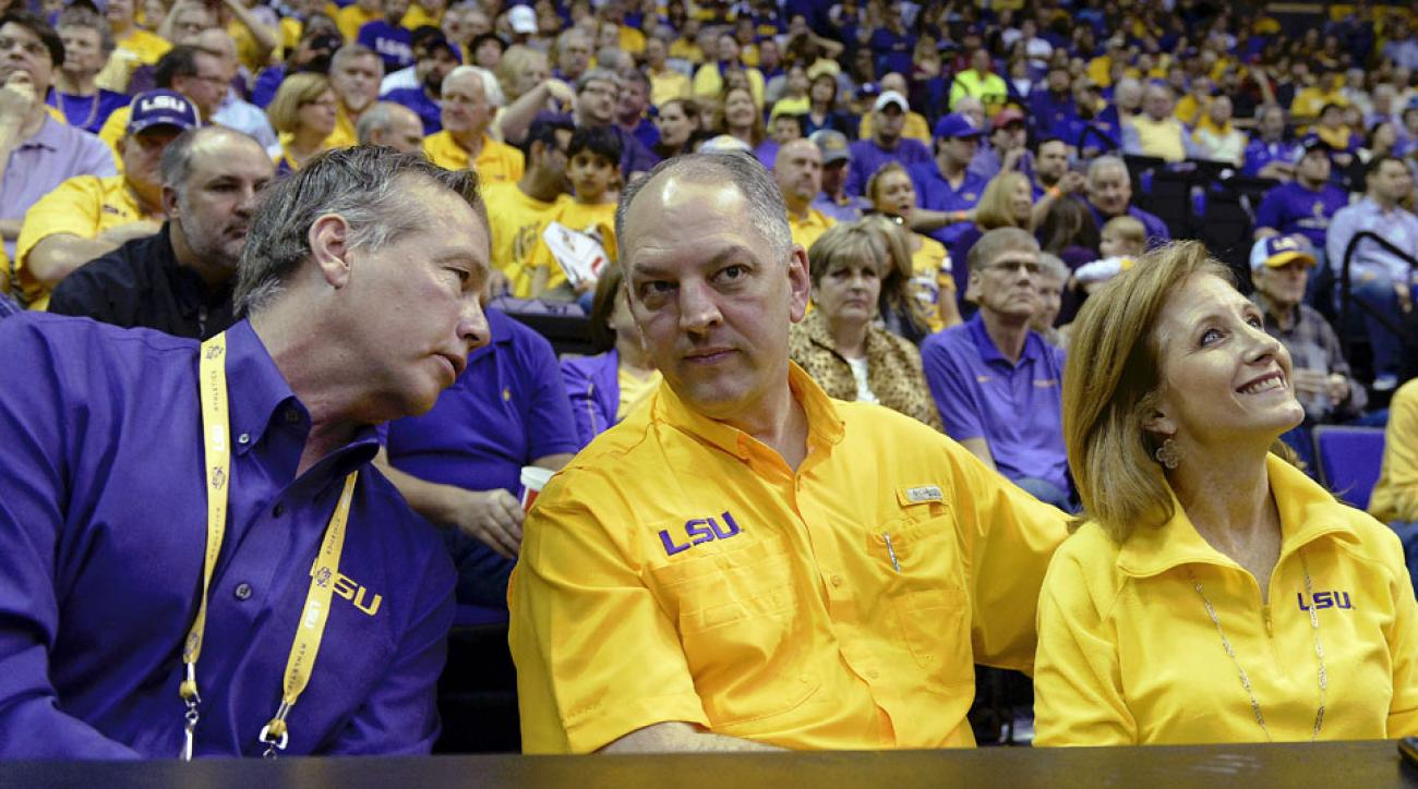 LSU president F. King Alexander (left) chats with Louisiana Gov. John Bel Edwards and his wife during the basketball game between Oklahoma and LSU.