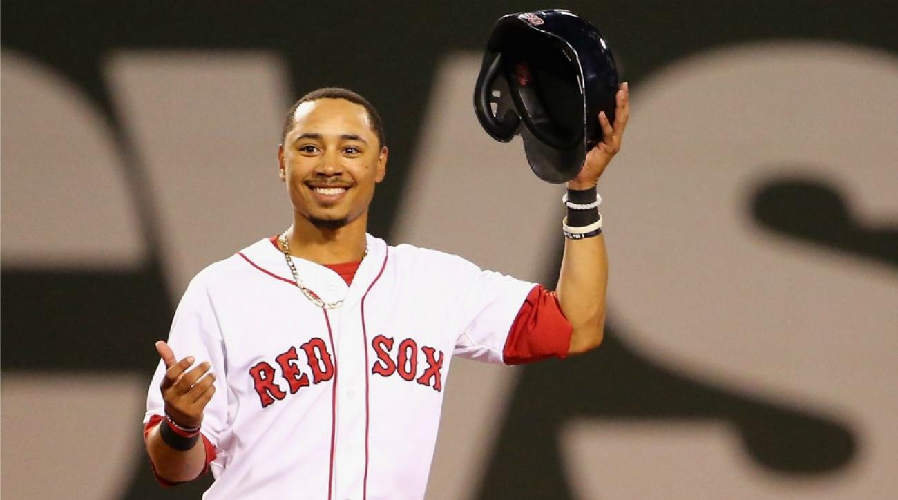 Boston Red Sox' Mookie Betts drove a golf cart into a pond