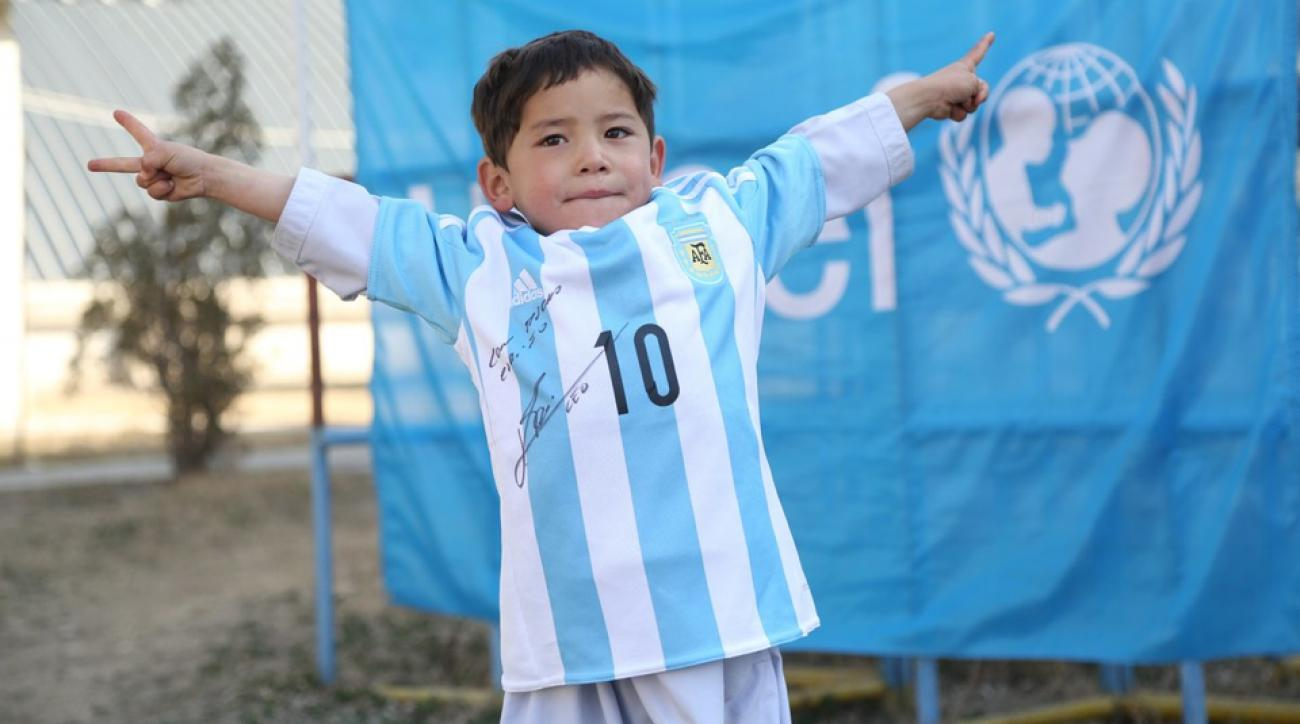 pretty nice dd373 5be63 Afghan boy with plastic Lionel Messi jersey gets signed kit ...