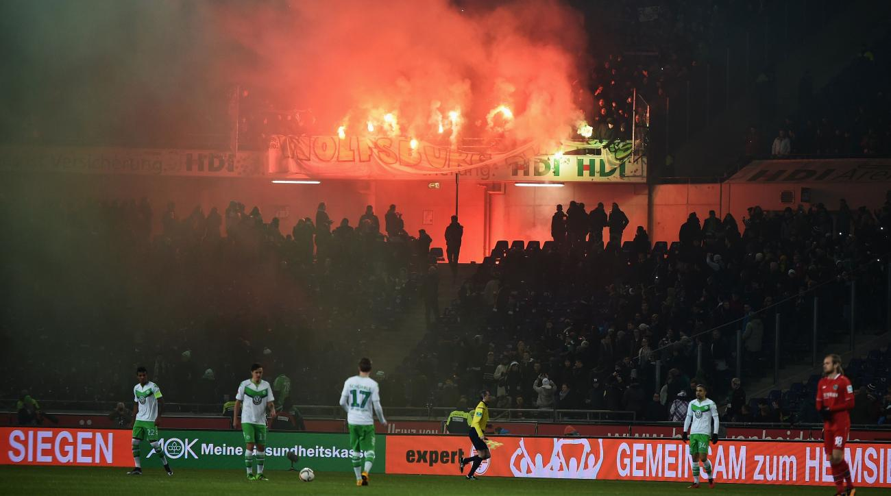 hannover wolfsburg fans flare bench