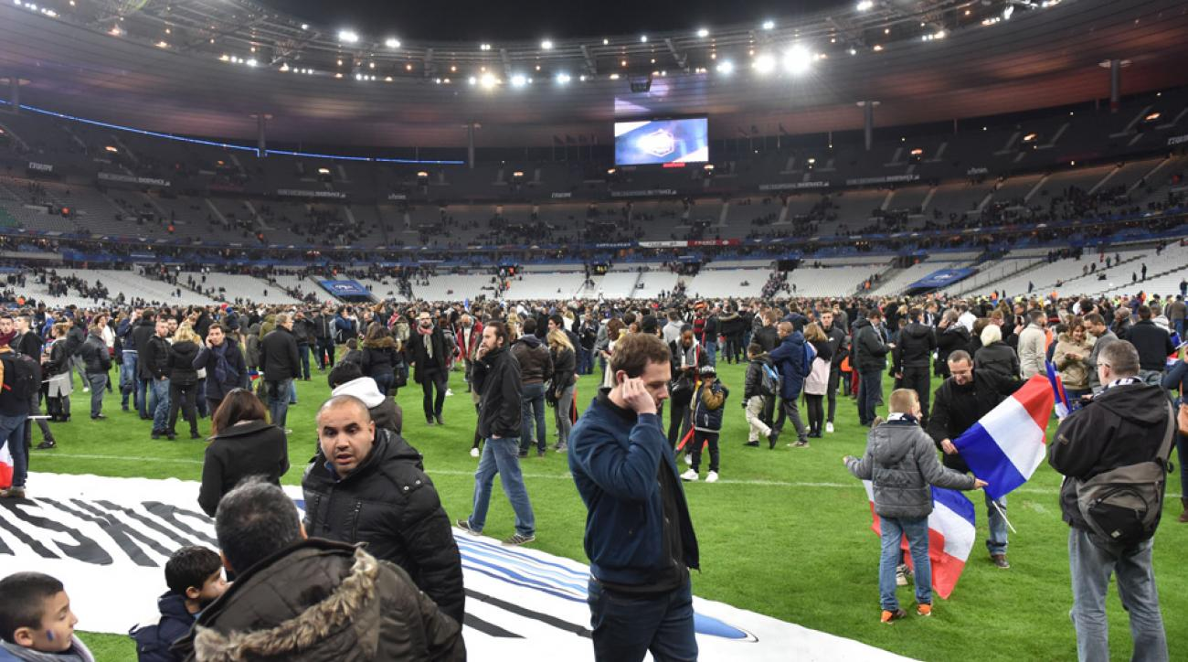 A terrorism attack outside Stade de France forced fans to convene on the field after a Germany-France friendly