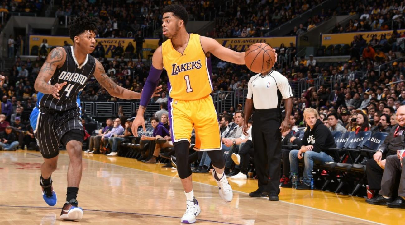 Lakers' D'Angelo Russell hits half court shot from seated position