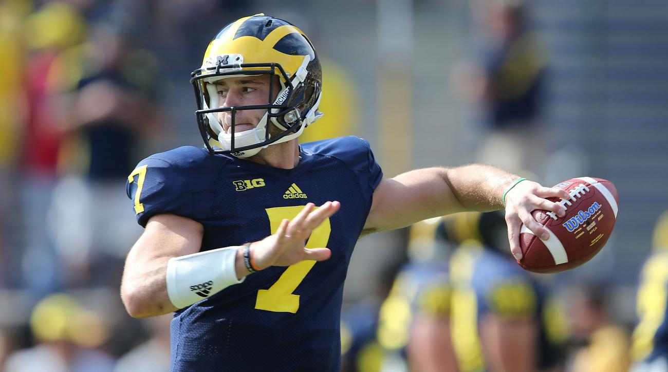 Michigan is in no rush to choose starting QB