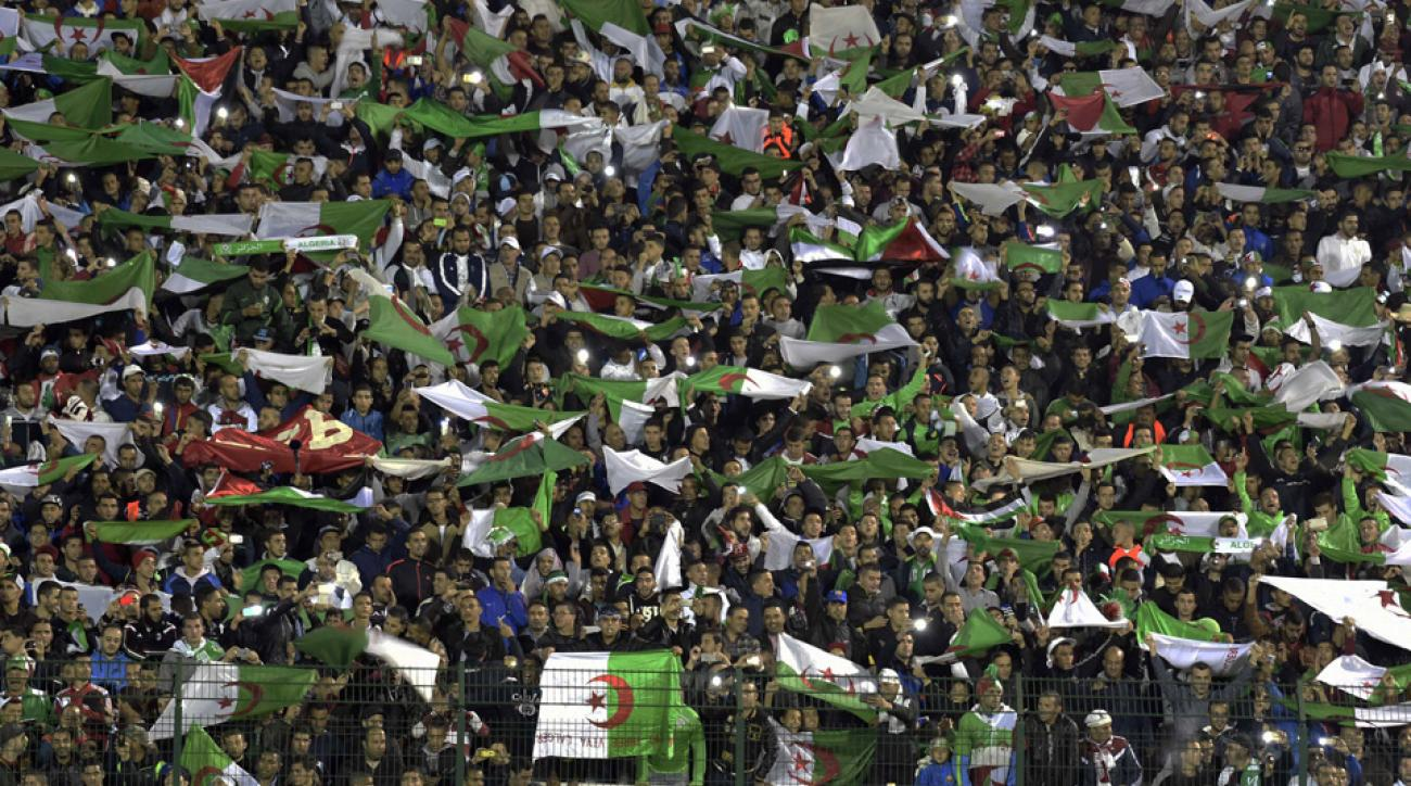 Algeria supporters wave their national flag