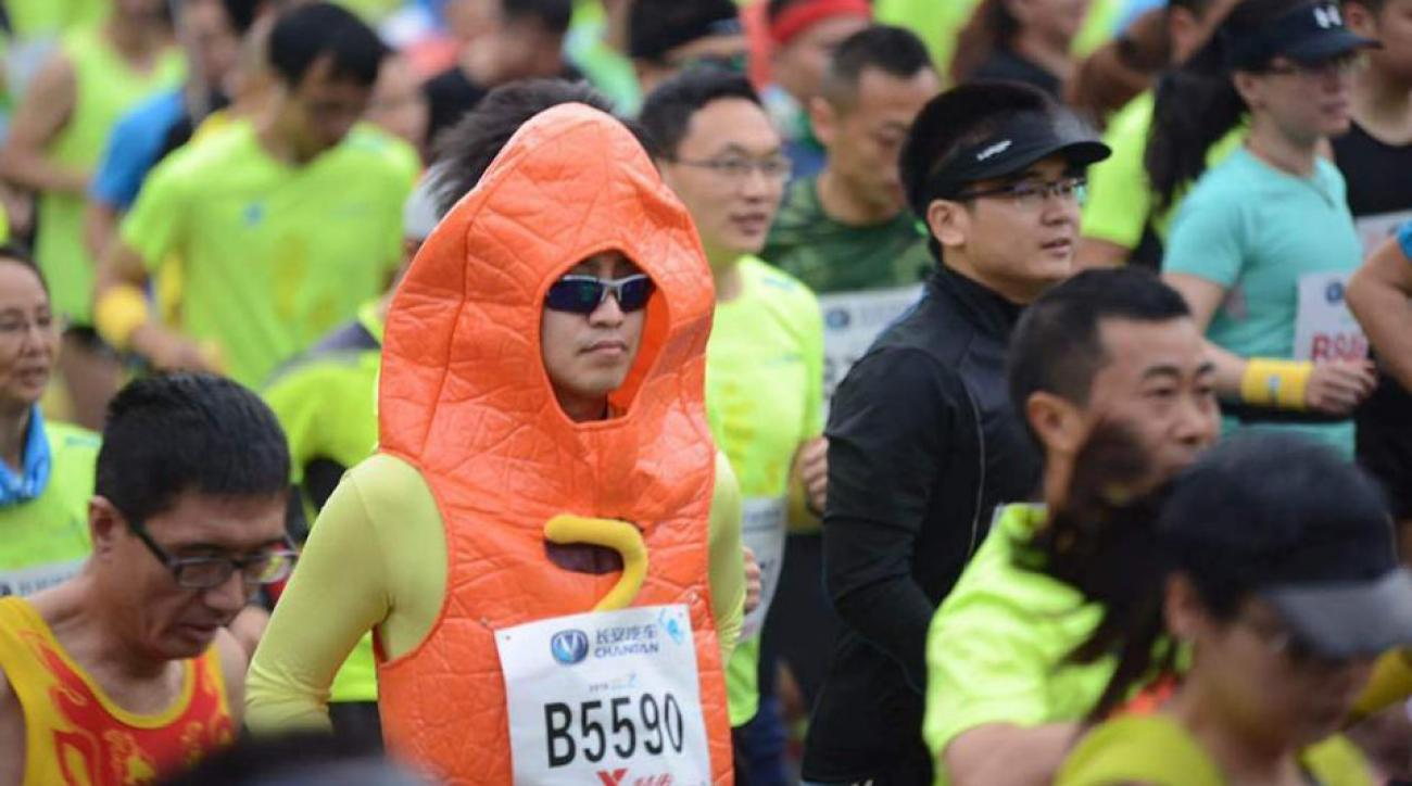 qingyuan china marathon runners eat soap energy bar