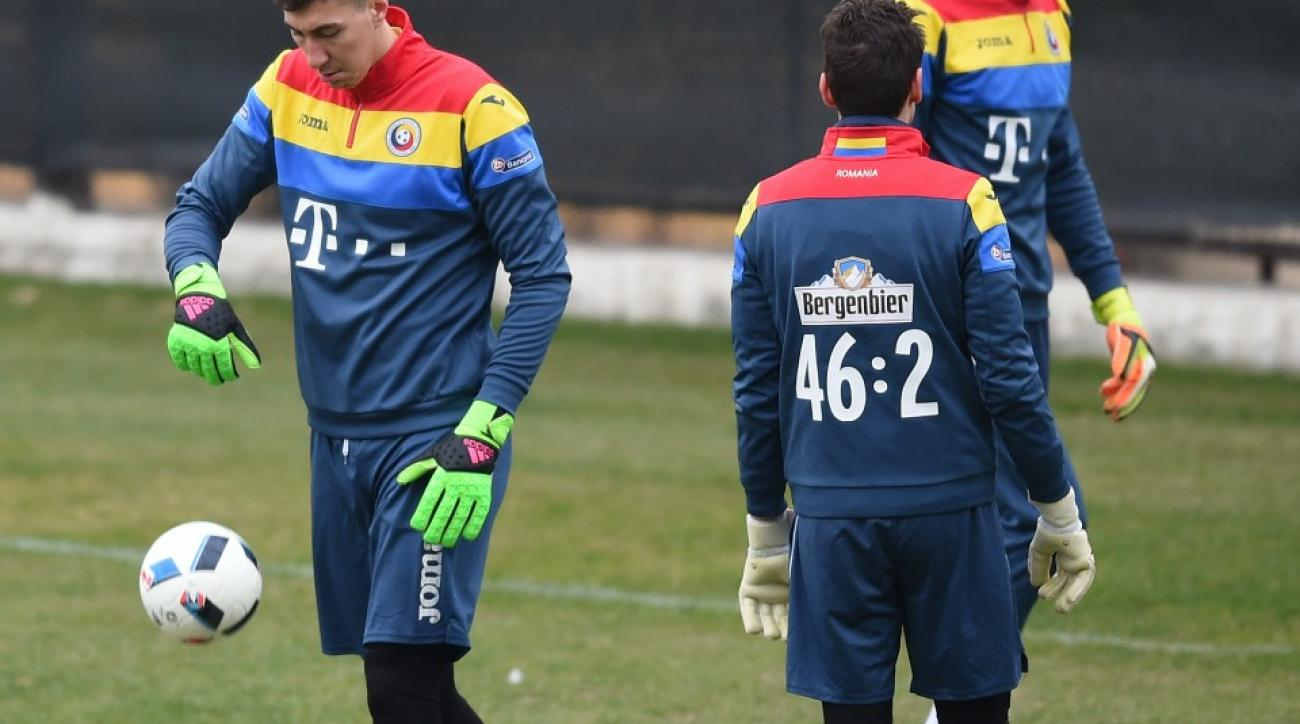 Romanian soccer teams wears math problems on warmups for Spain match