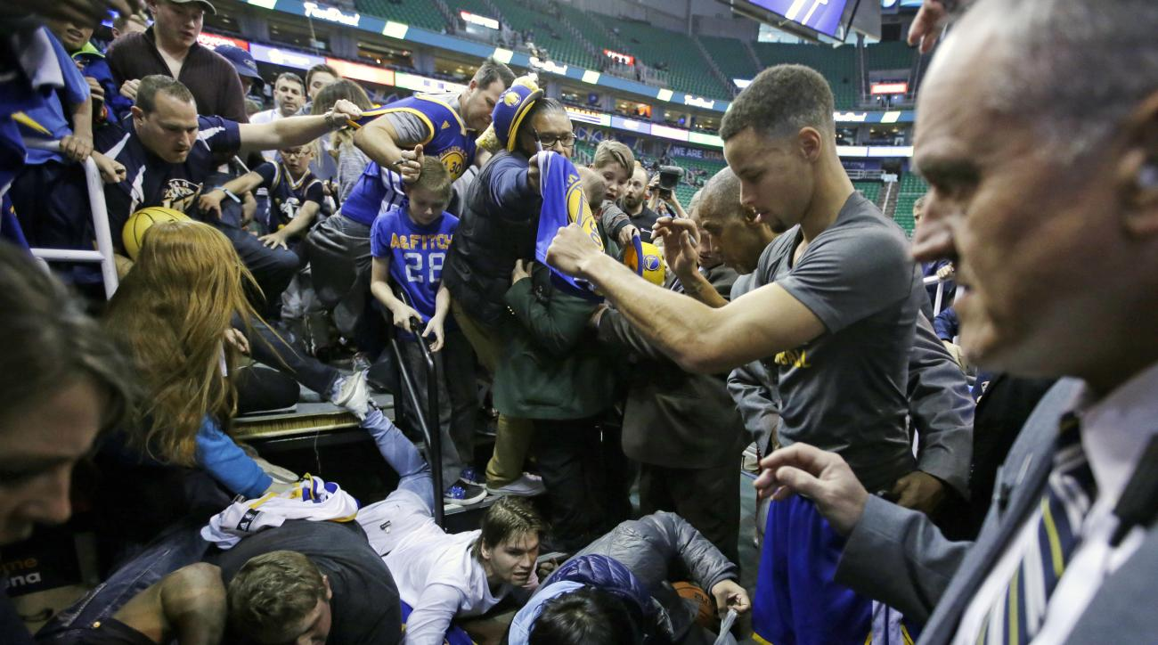 stephen curry golden state warriors fans fall from stands autograph