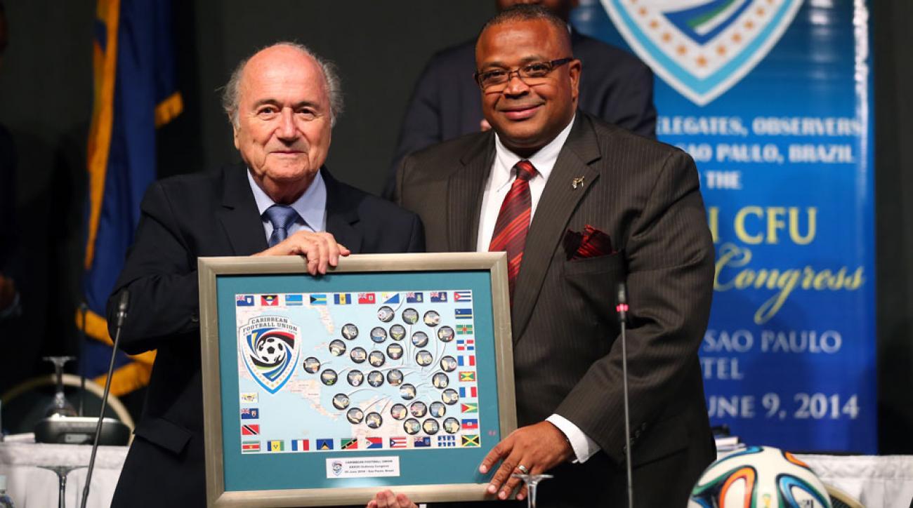 Caribbean Football Union president Gordon Derrick, right, with Sepp Blatter