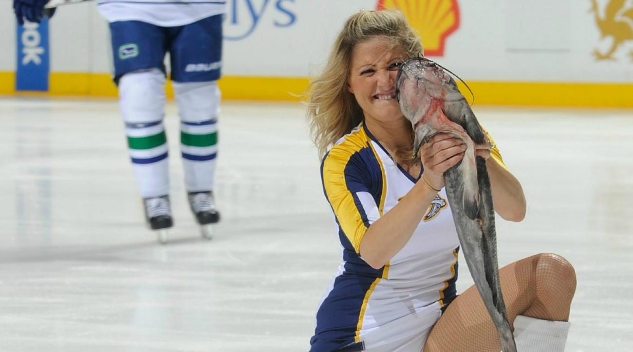 Nashville Predators fans throw catfish onto the ice for home playoff games