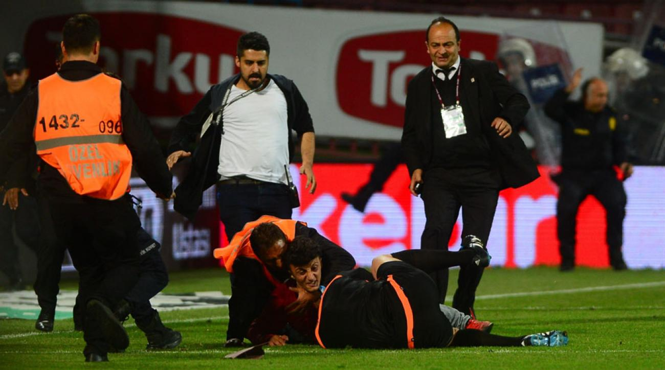 Trabzonspor fans attack an assistant referee in Turkey