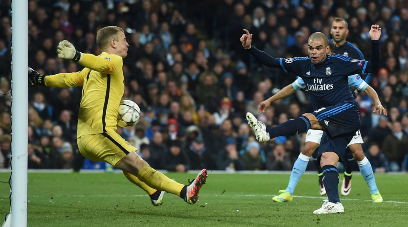 Joe Hart stops Pepe in a key moment in Manchester City's 0-0 draw with Real Madrid in Champions League