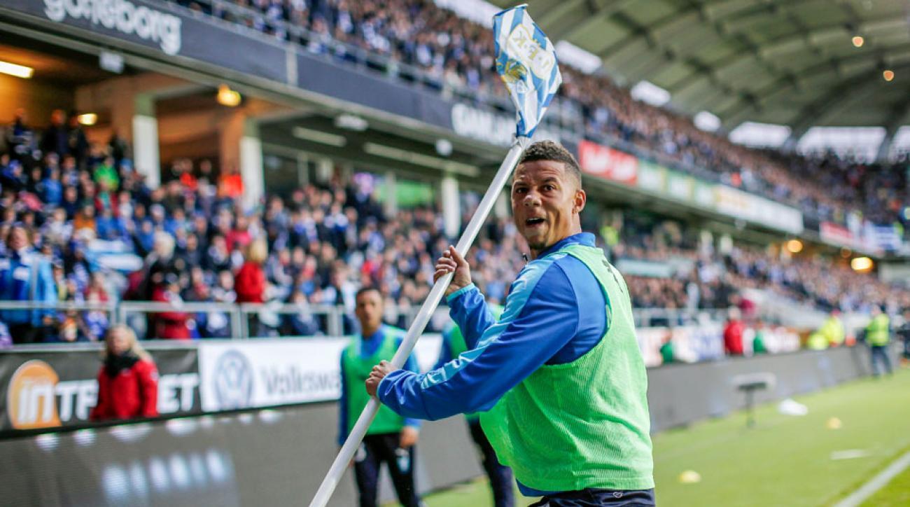Tobias Sana throws a corner flag at Goteborg fans