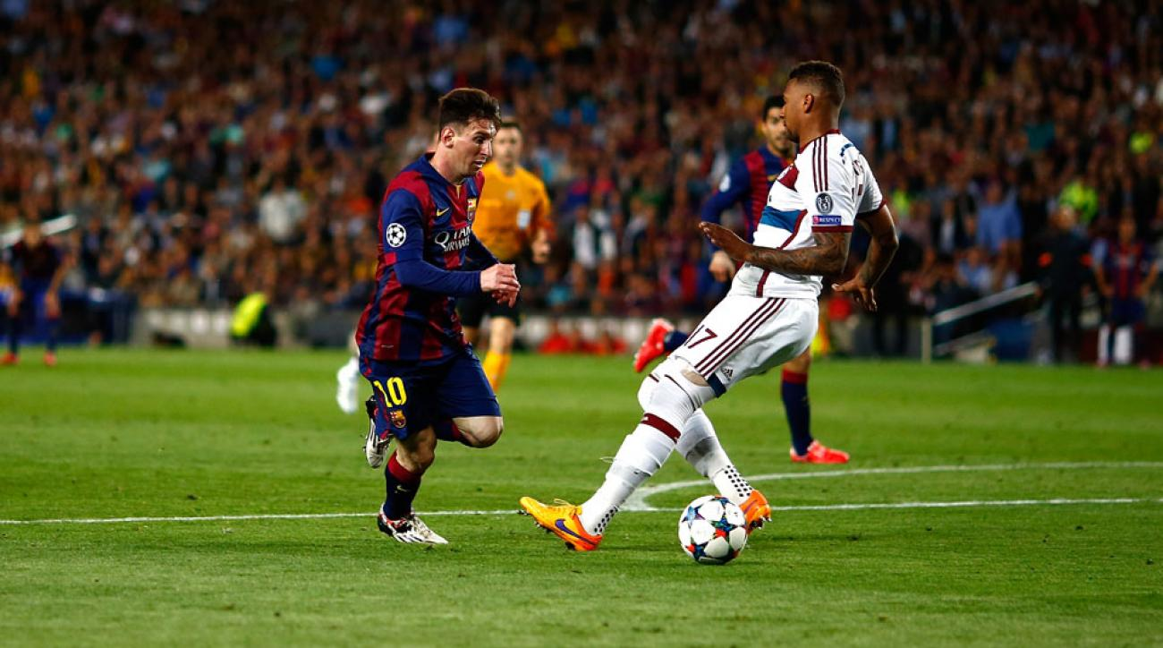 Lionel Messi scores on Jerome Boateng in the Champions League