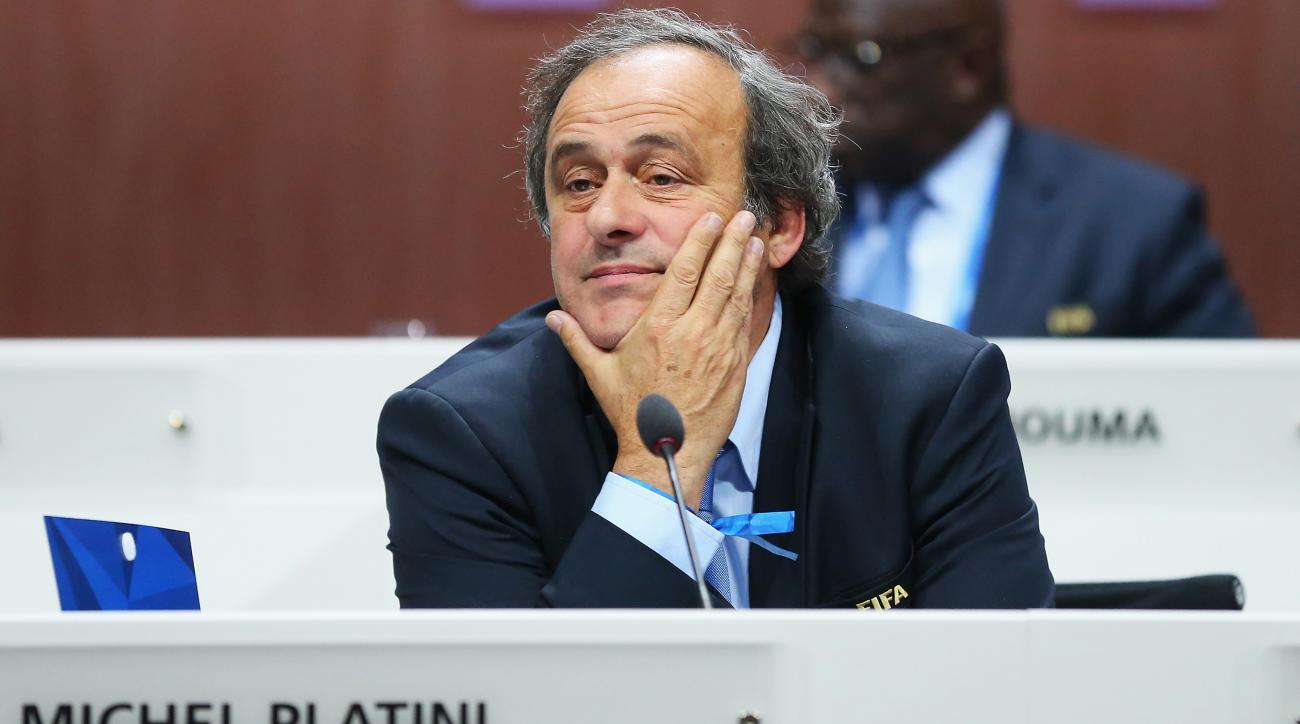 michel platini resigns uefa president fifa ban reduced