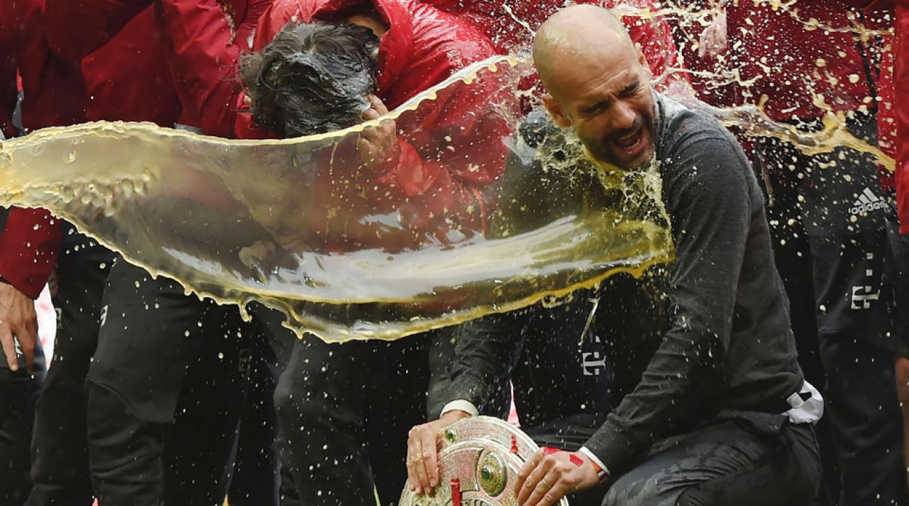 Pep Guardiola gets nailed with a beer in his Bayern Munich home finale