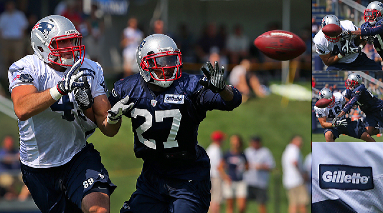 For years, NFL teams have been wearing sponsorship ads on their jerseys during training camp. Here, Patriots safety Tavon Wilson knocked down a pass intended for tight end Alex Silvestro in 2012.