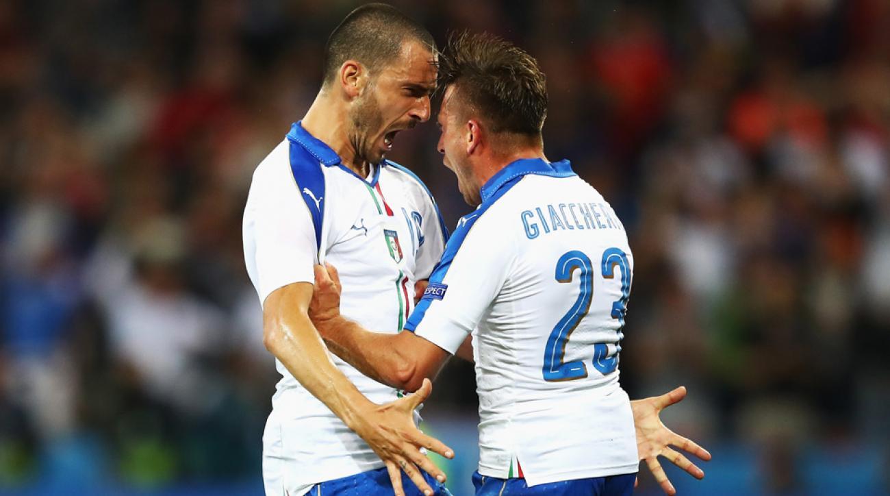 Emanuele Giaccherini and Leonardo Bonucci celebrate Italy's goal vs. Belgium