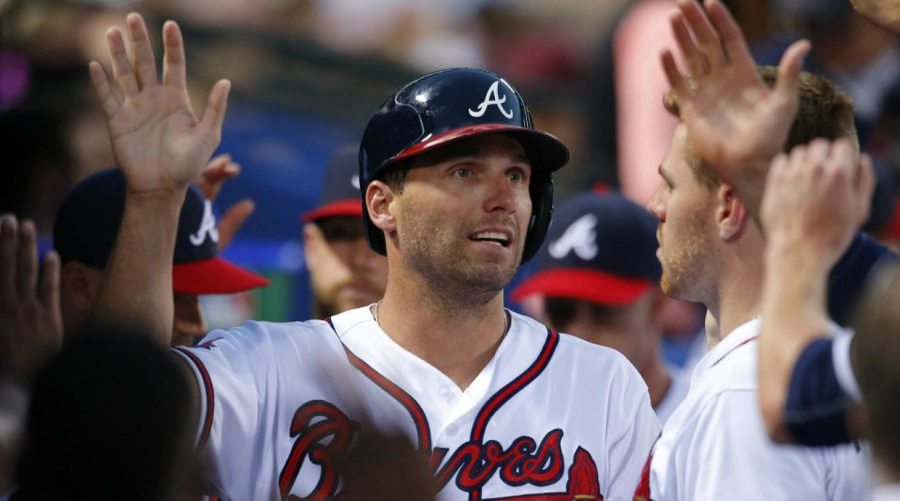 Chase d'Arnaud sings to Jeff Francoeur by the pool in Miami