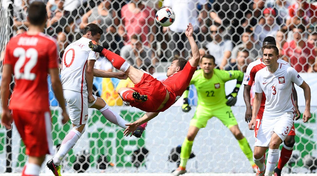 Xherdan Shaqiri scores his bicycle kick goal for Switzerland vs. Poland