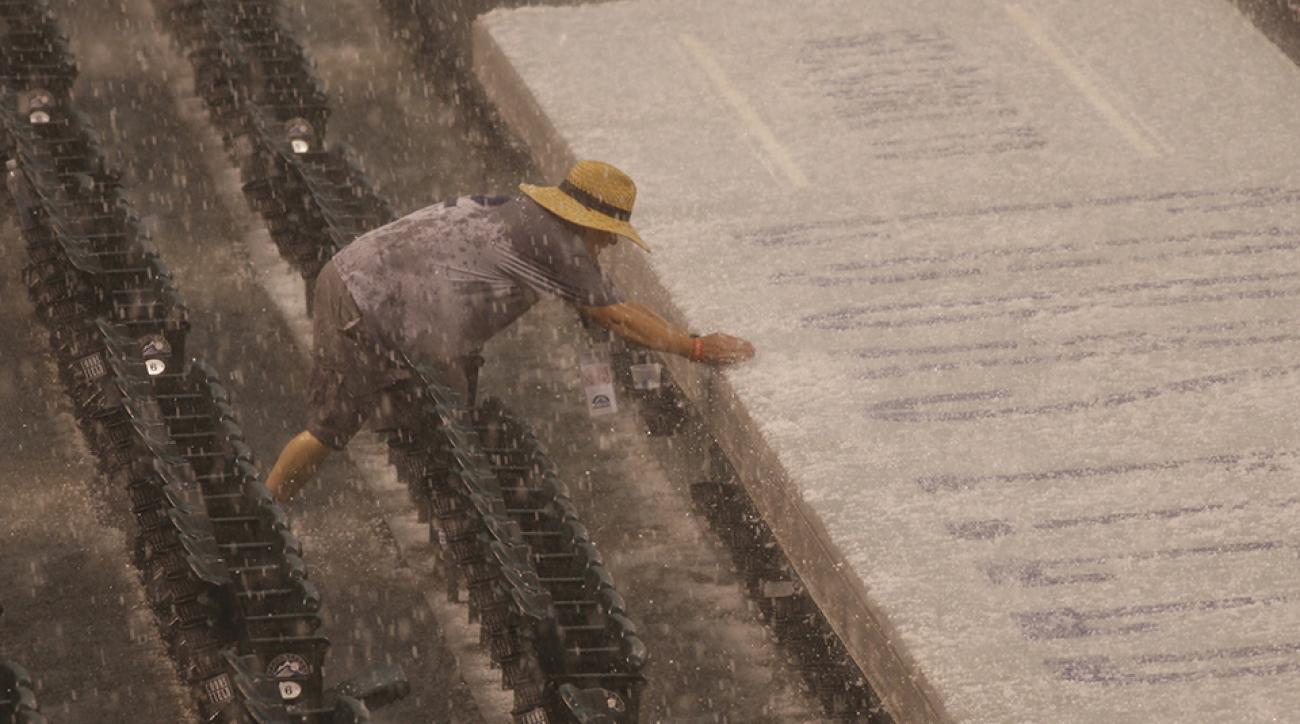 blue jays rockies rain delay hail storm photo video