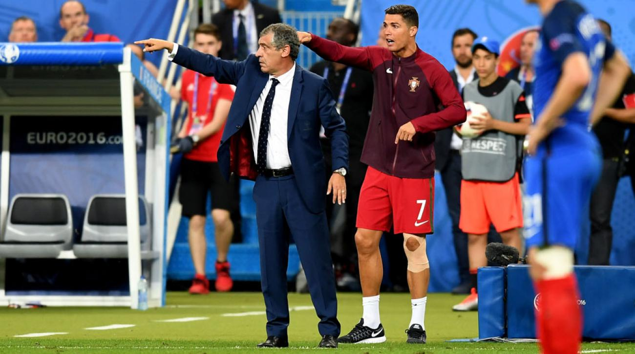 Cristiano Ronaldo and Fernando Santos gesticulate on the sideline in the Euro 2016 final
