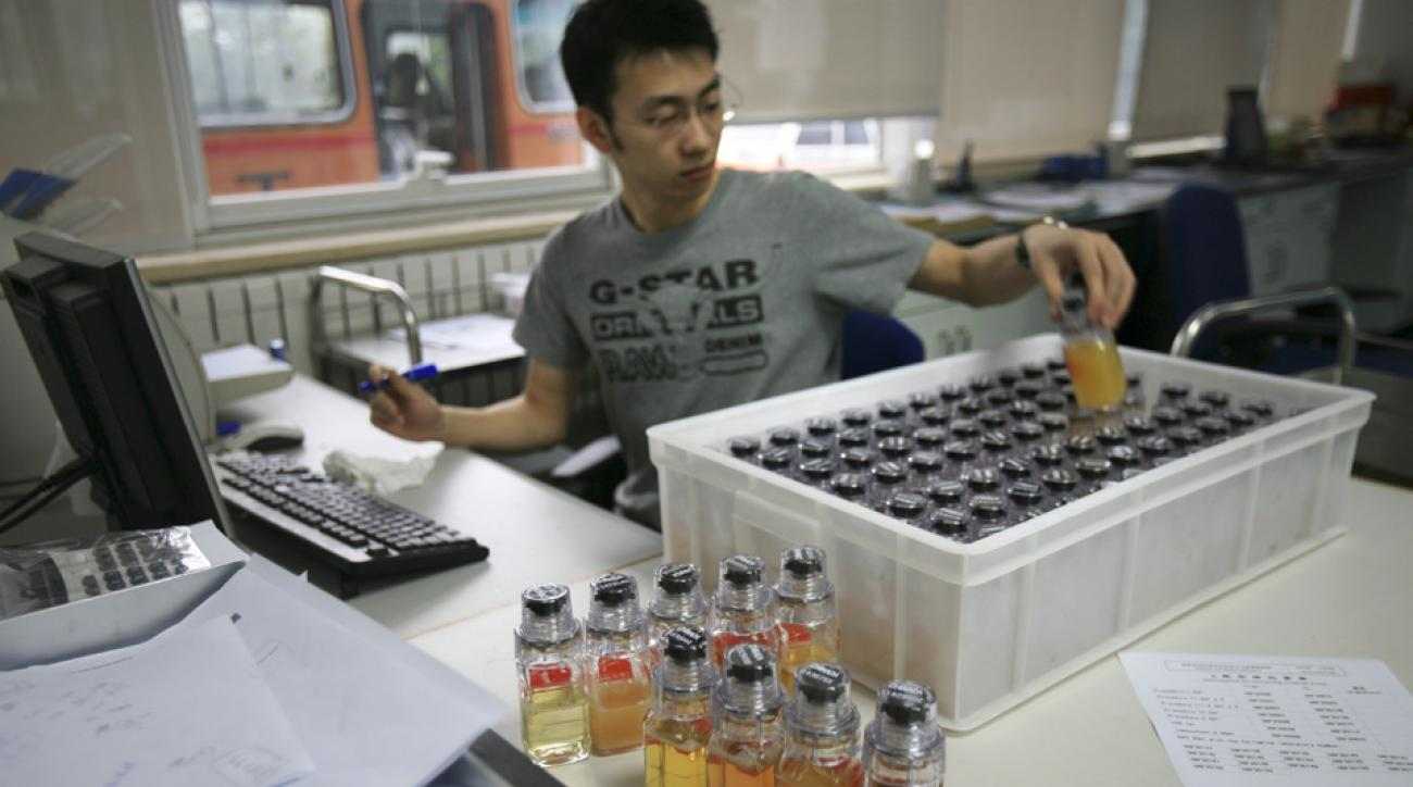olympics doping retesting positive cases