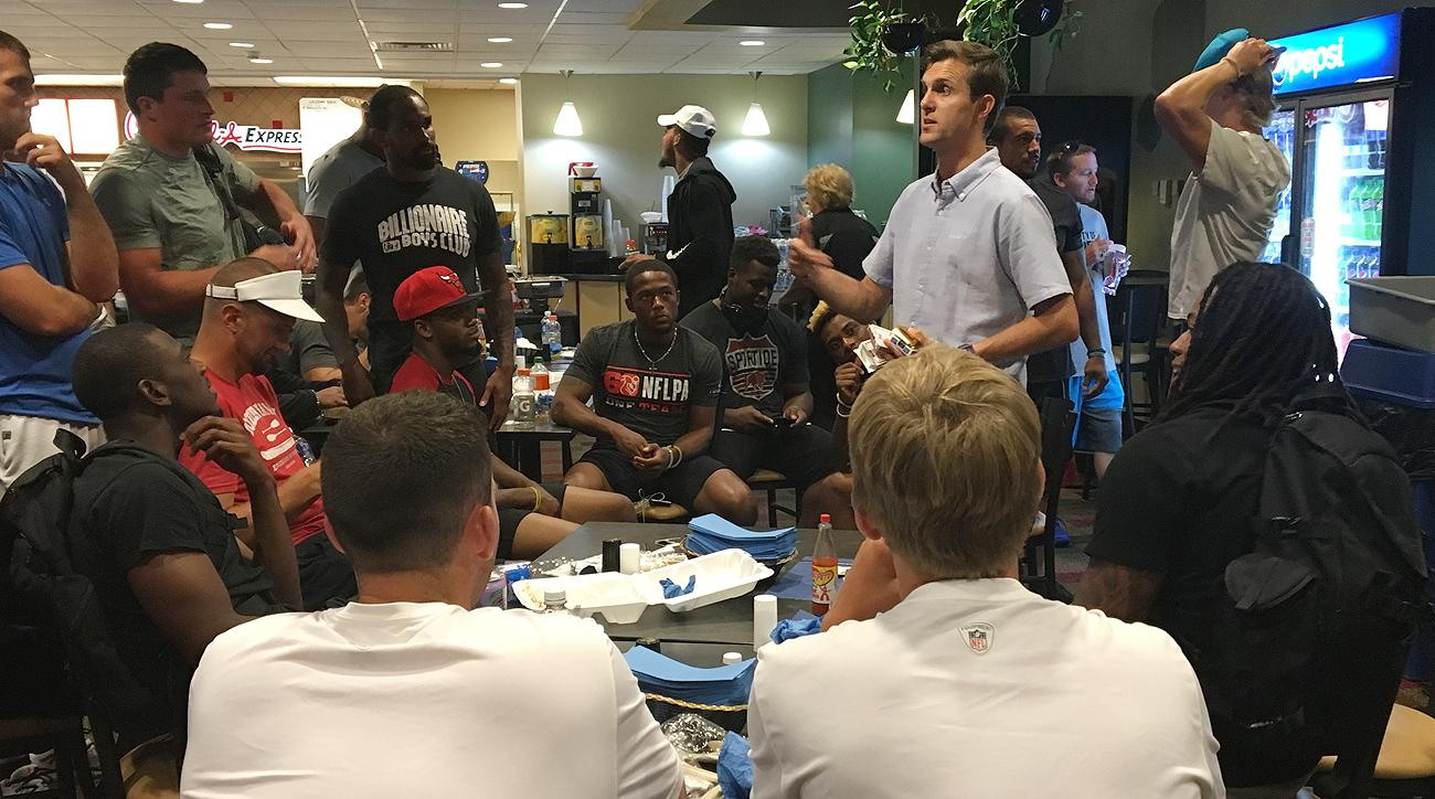 Magician Carl Michael performed card tricks to a group of enthralled Panthers players over lunch on Thursday.