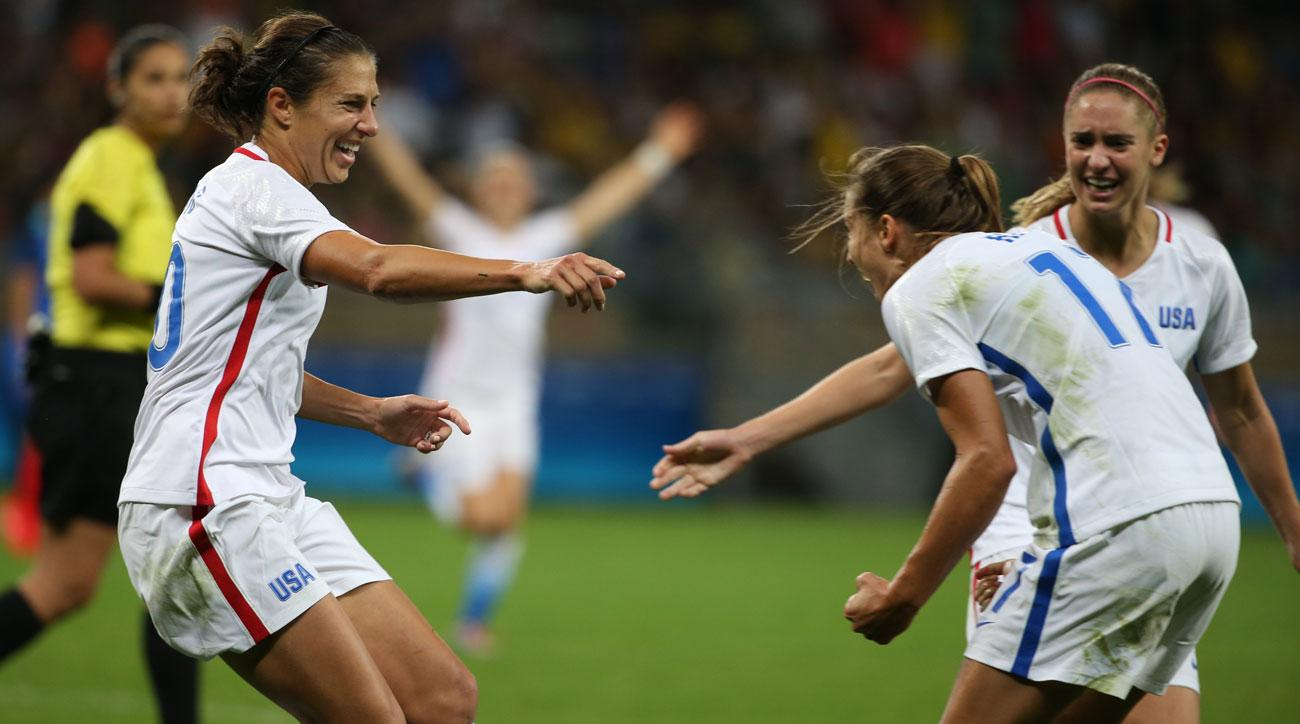 Carli Lloyd celebrates her goal in the USA's Olympic battle vs. France
