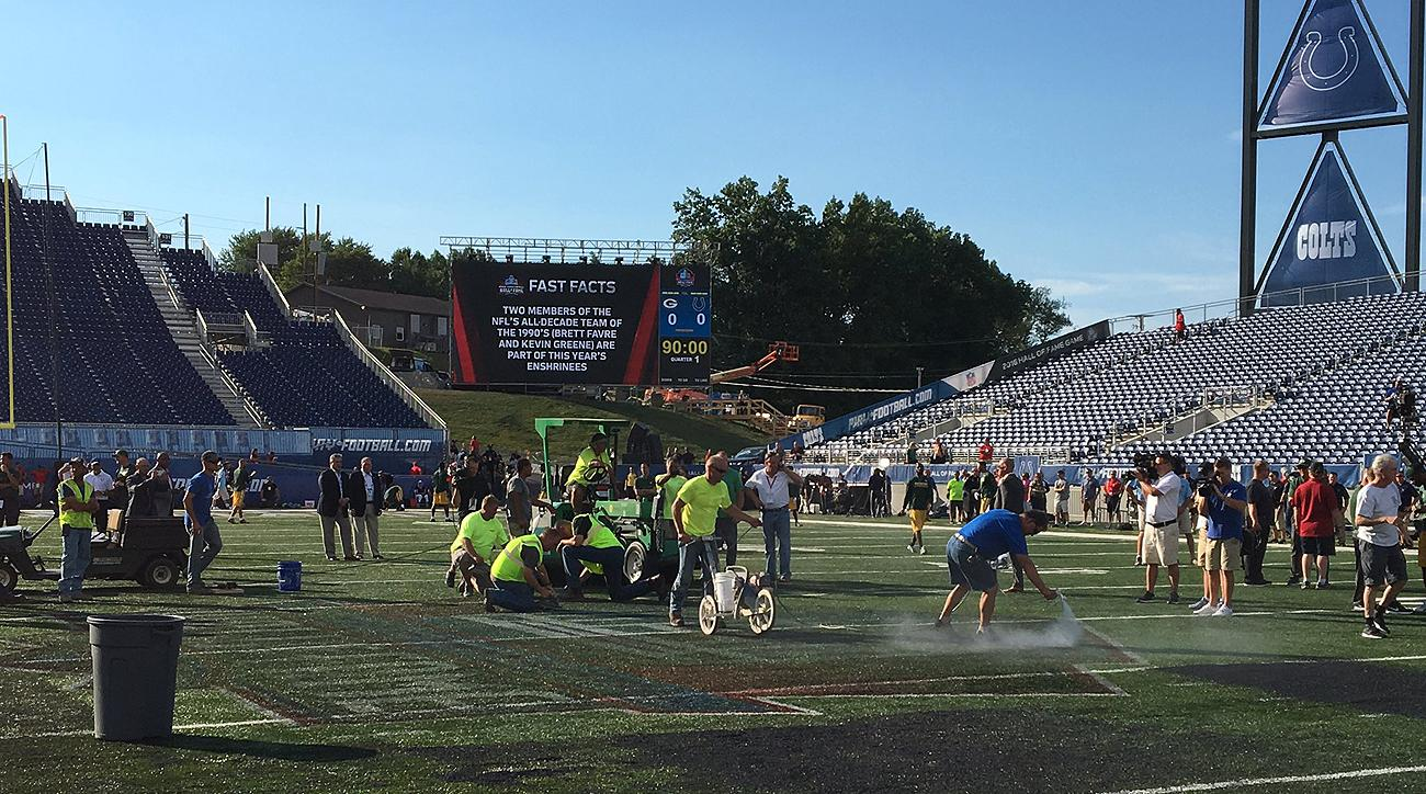Field maintenance workers scrambled to get the turf ready for Sunday night's game, which ultimately was cancelled due to unsafe playing conditions.