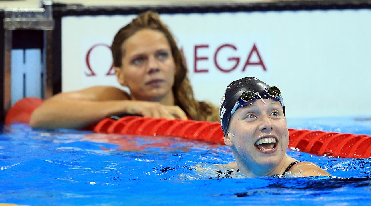 USA's Lilly King (front) reacts to winning the 100m breaststroke finals as Russia's Yulia Efimova looks on.