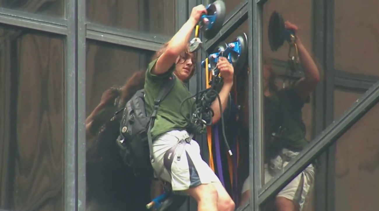 trump tower man climb suction cups video