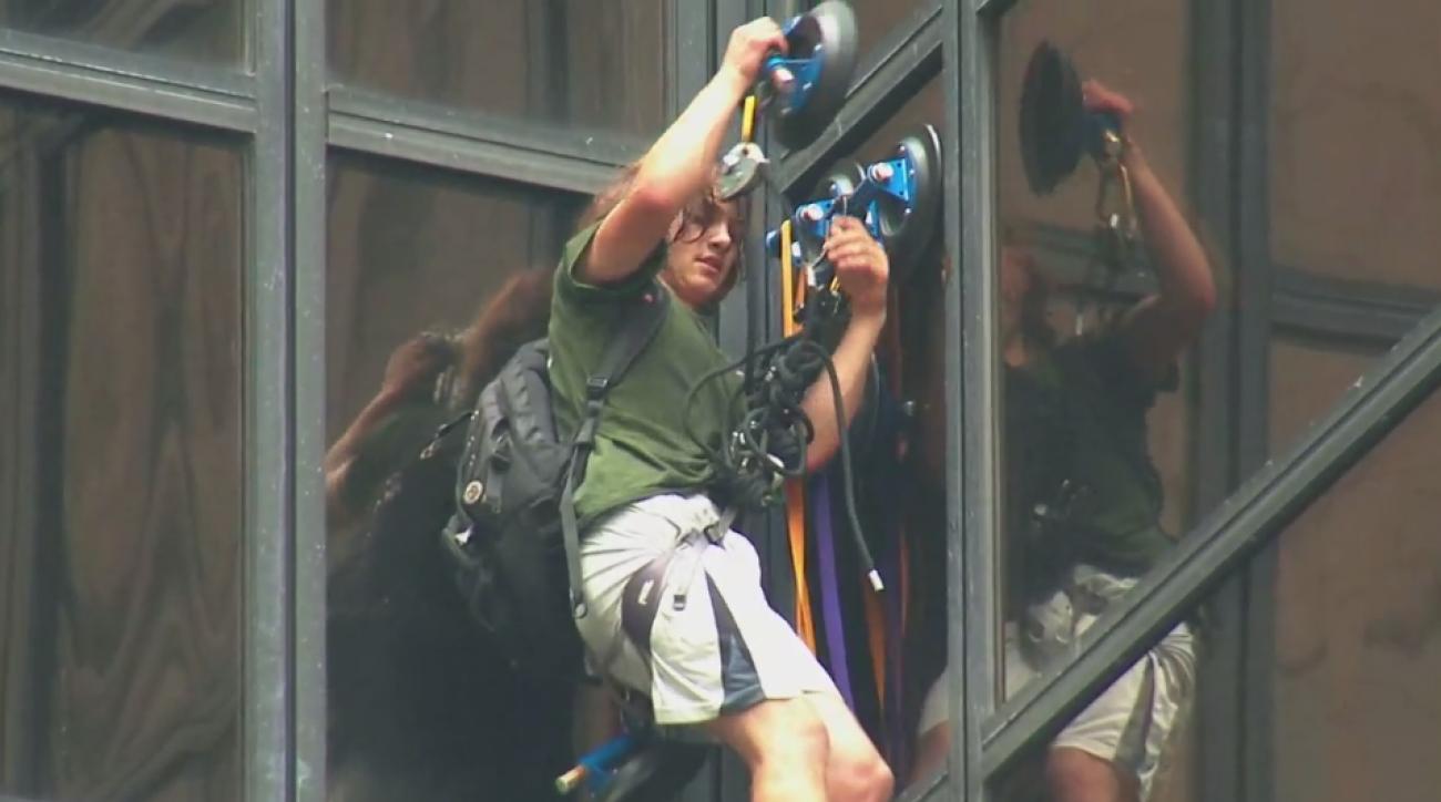 trump tower man climb suction cups video