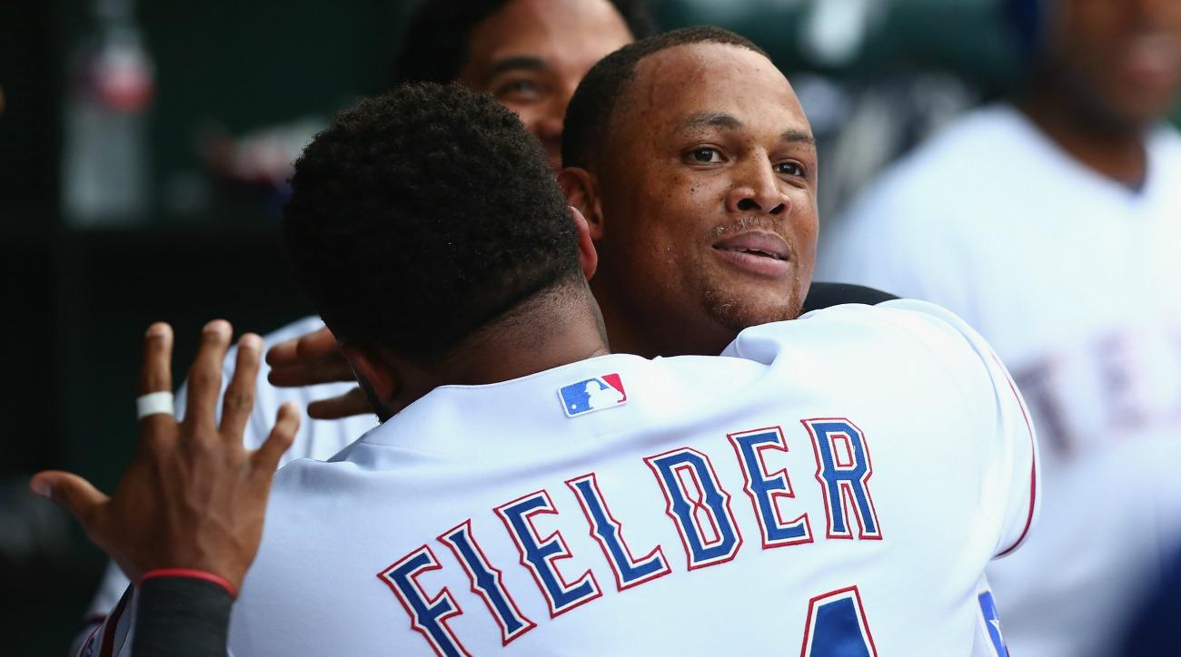 Prince Fielder touches Adrian Beltre's head one last time