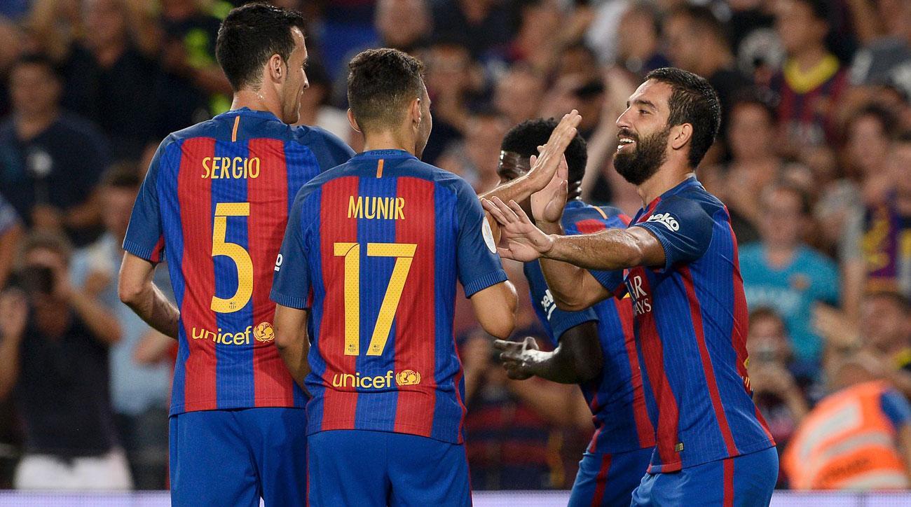 Arda Turan scores for Barcelona vs. Sevilla in the Spanish Super Cup
