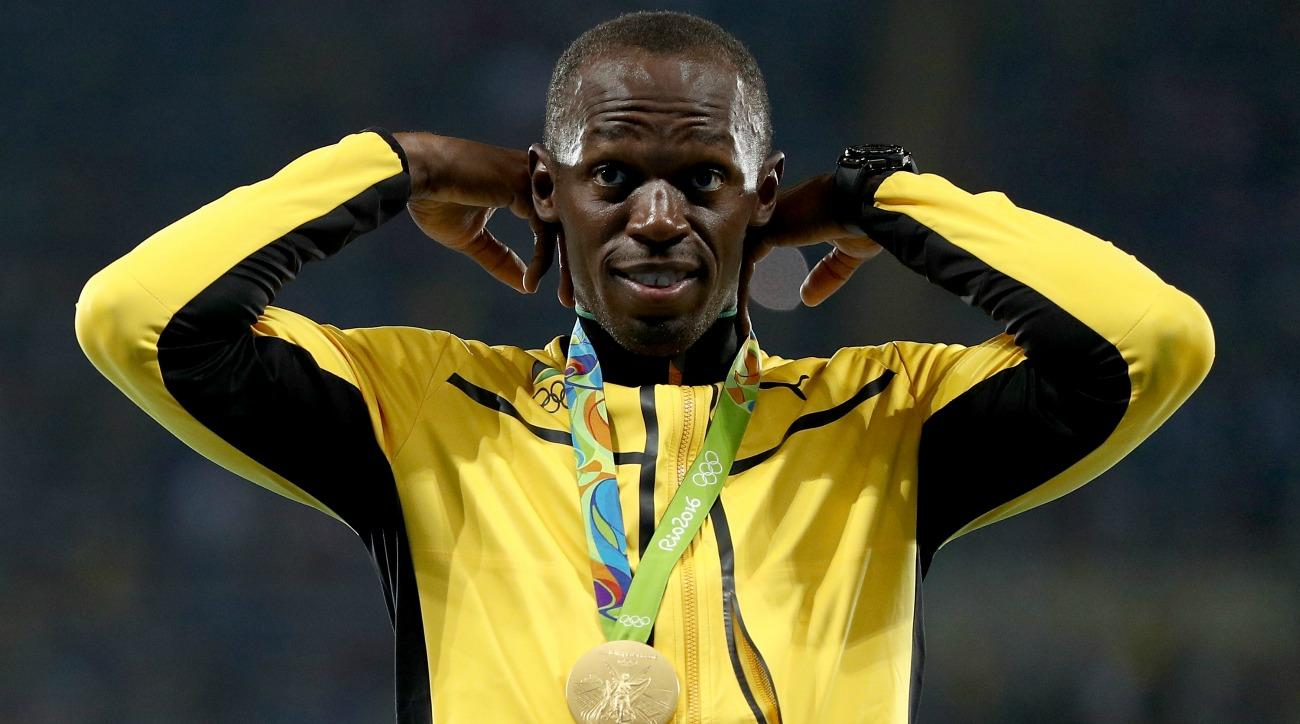 Usain Bolt threw a javelin after winning his ninth gold medal