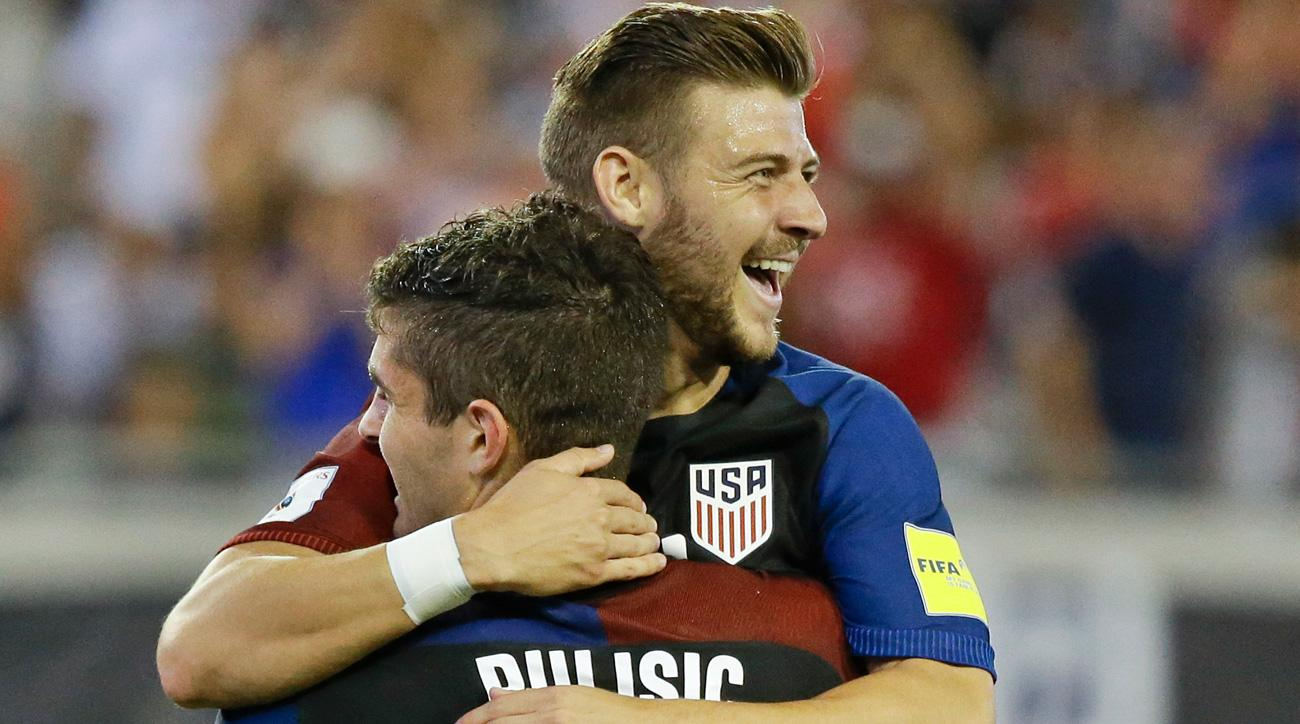Paul Arriola, Christian Pulisic celebrate the USA's World Cup qualifying win over Trinidad and Tobago