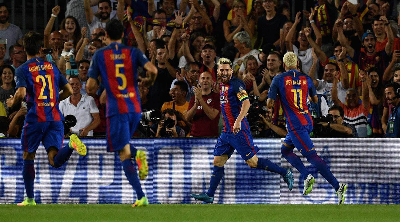 Messi and Neymar celebrate in Barcelona's Champions League match vs. Celtic