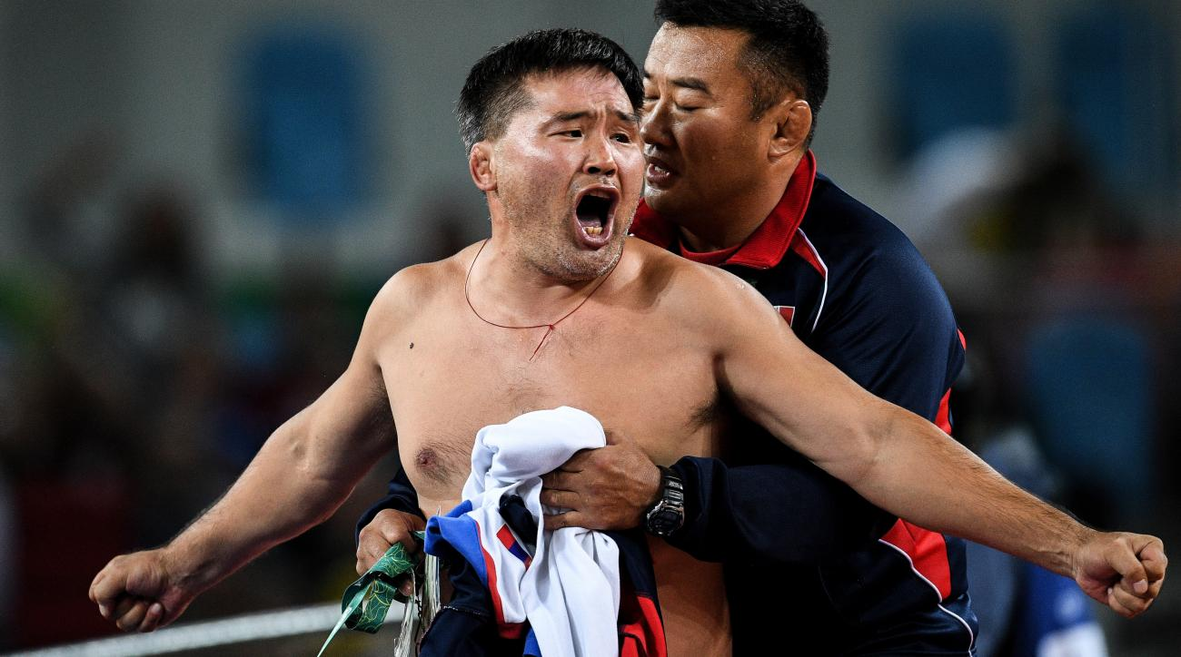 mongolia wrestling olympics coaches strip suspension three years