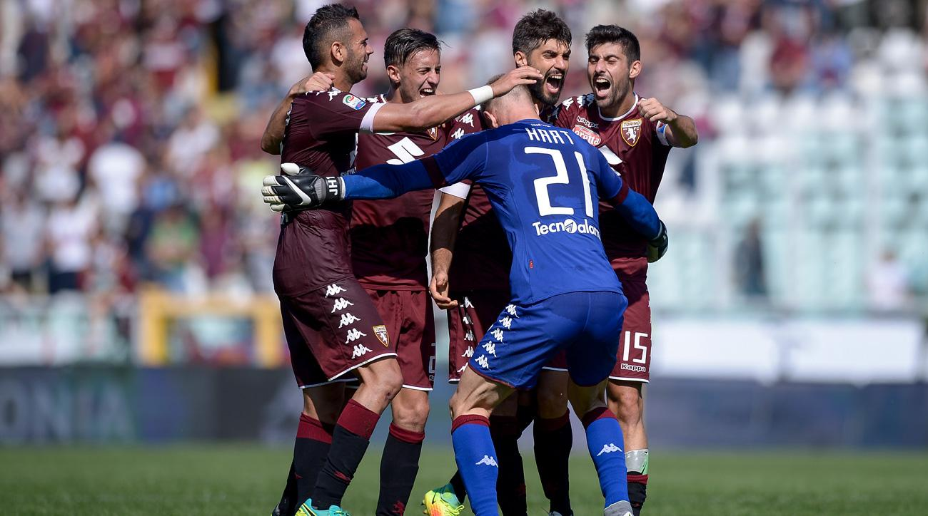 Joe Hart celebrates with his Torino teammates after beating Roma