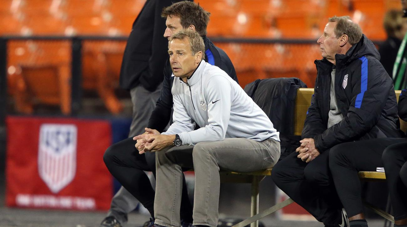 Jurgen Klinsmann and his assistants watch the USA take on New Zealand in Washington D.C.