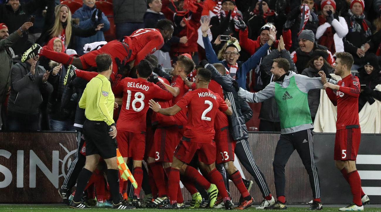 Toronto FC celebrates Tosaint Ricketts' late goal in a playoff win over NYCFC