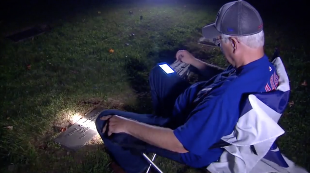 Cubs World Series: Fan listens to Game 7 at father's grave