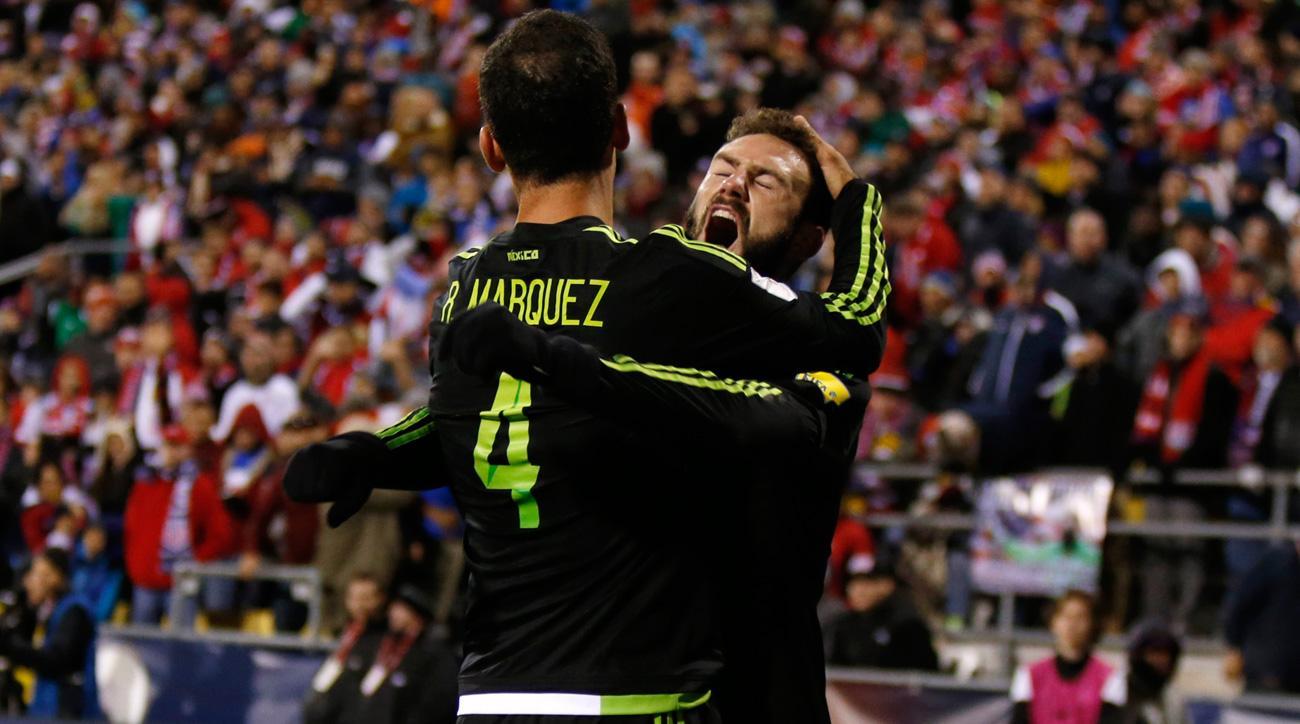 Rafa Marquez and Miguel Layun celebrate Mexico's 2-1 win over USA in Columbus