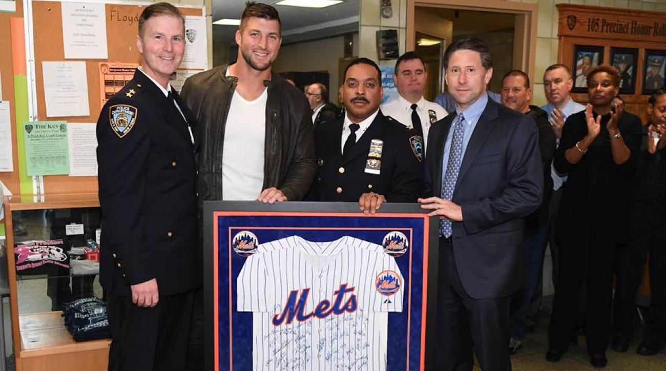 tim tebow visits nypd and donates jersey