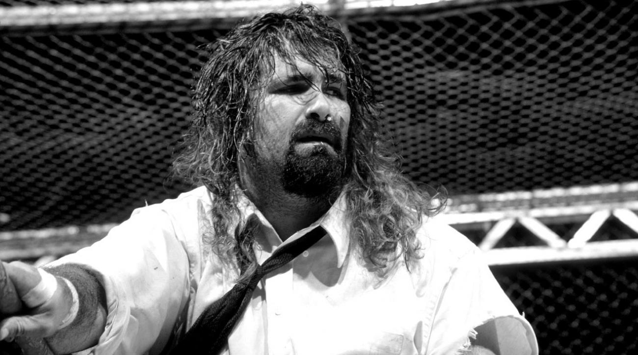 WWE Raw: Mick Foley loses HIAC tooth (video)